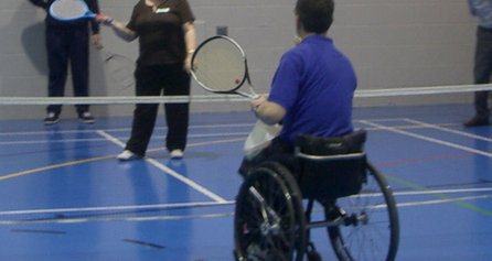 People with disabilities playing tennis